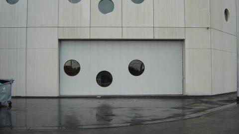 Unique porte industriel coulissante circulaire