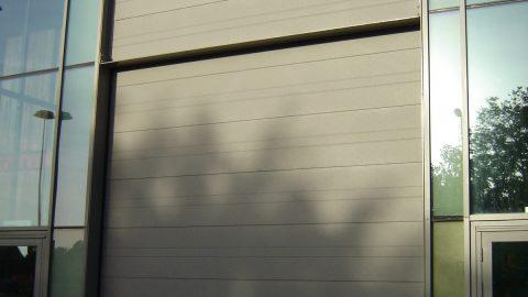 Portes sectionelles insonorisantes - Patronaat - Protec Industrial Doors