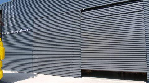 Portes identiques à la façade - Pas Reform - Protec Industrial Doors