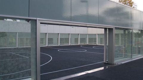 Portes vitrées à commande électrique - Portes en verre - Place des sports sur le campus